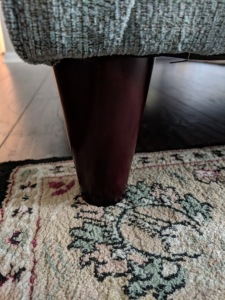 couch leg on the corner of a rug